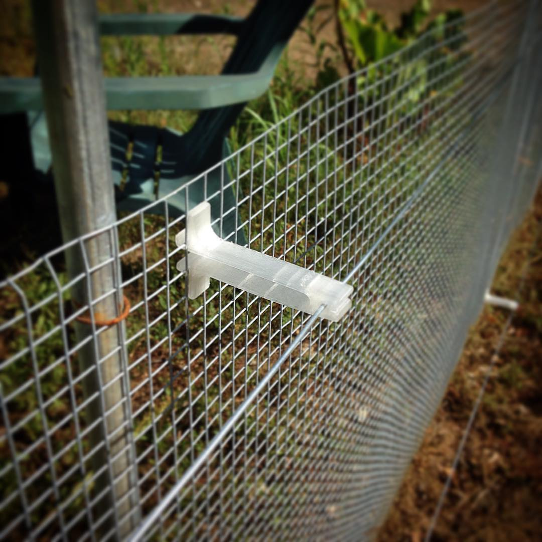 3D printed electric fence supports. Welcome to Jurassic Garden!