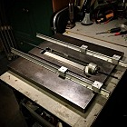 One of the things that I learned with my first 3-D printer was that a rigid and heavy base improved repeatability. So my new printer is starting with the cast-iron top of an old school craftsman table saw.