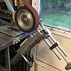 "Surface grinder attachment for the belt grinder. The ""magnetic chuck"" is a $23 magnetic door lock."