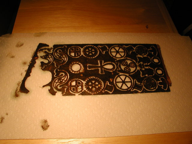 steampunk charms etched from brass