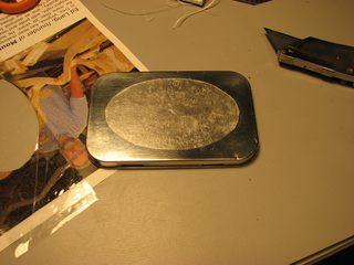 altoids tin with tape mask