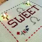 Cross stitch made with conductive thread