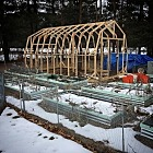 Framing for the greenhouse is done. The wood will be primed and painted the same color as the beds but I won
